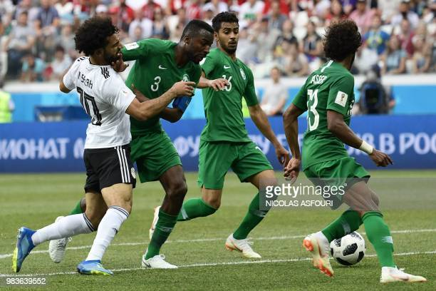 Egypt's forward Mohamed Salah is blocked by Saudi Arabia's defender Osama Hawsawi during the Russia 2018 World Cup Group A football match between...
