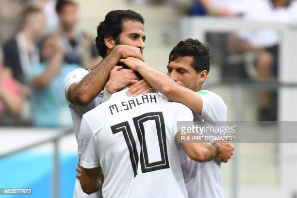 TOPSHOT Egypt's forward Mohamed Salah is congratulated by teammates after scoring during the Russia 2018 World Cup Group A football match between...