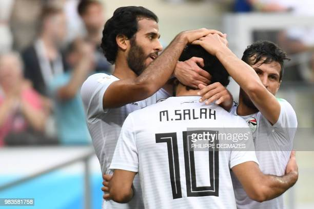 Egypt's forward Mohamed Salah is congratulated by teammates after scoring during the Russia 2018 World Cup Group A football match between Saudi...