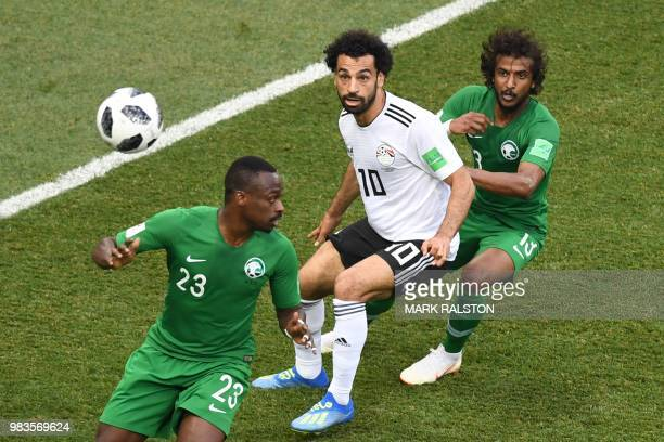Egypt's forward Mohamed Salah is marked by Saudi Arabia's defender Yasser AlShahrani as the cross comes in during the Russia 2018 World Cup Group A...