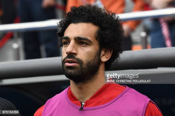 TOPSHOT Egypt's forward Mohamed Salah is seen by the substitutes bench before kick off of the Russia 2018 World Cup Group A football match between...