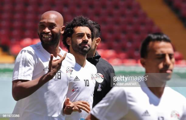 Egypt's forward Mohamed Salah jogs with Egypt's forward Mahmoud 'Shikabala' Abdel Razek and teammates during a training session at the Akhmat Arena...