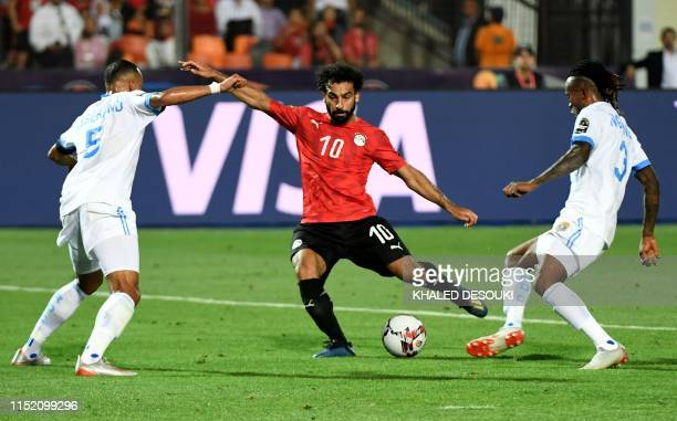 Egypt's forward Mohamed Salah kicks the ball and scores a goal during the 2019 Africa Cup of Nations football match between Egypt and DR Congo at the...