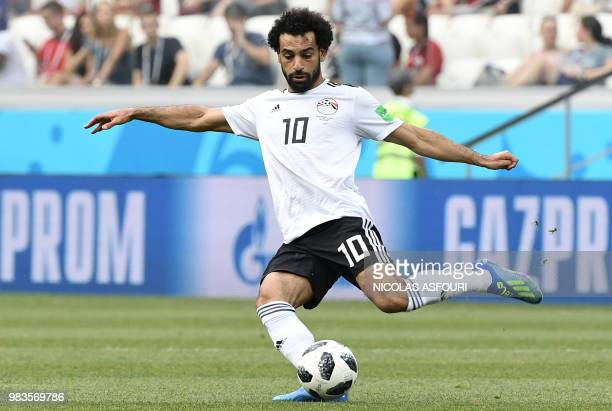 Egypt's forward Mohamed Salah kicks the ball during the Russia 2018 World Cup Group A football match between Saudi Arabia and Egypt at the Volgograd...