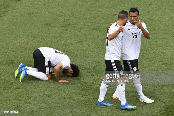 TOPSHOT Egypt's forward Mohamed Salah kneels to celebrate his opening goal during the Russia 2018 World Cup Group A football match between Saudi...