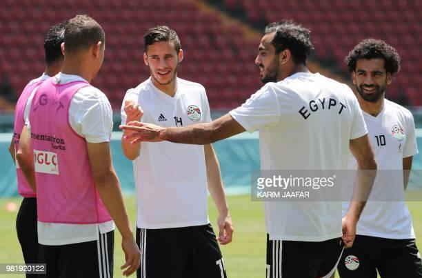 Egypt's forward Mohamed Salah listens to Egypt's midfielder Ramadan Sobhi and teammates during a training session at the Akhmat Arena stadium in...