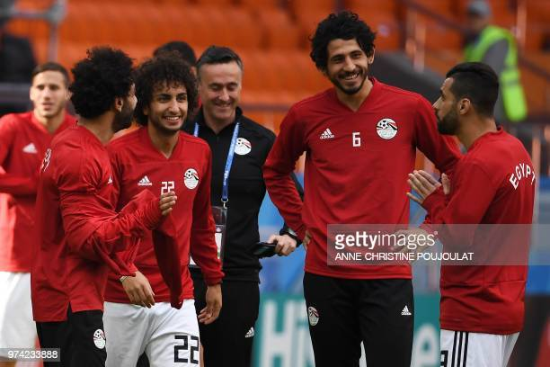Egypt's forward Mohamed Salah midfielder Amr Warda defender Ahmed Hegazi and midfielder Abdallah Said talk as they take part in a training session at...