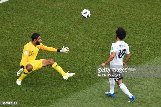 TOPSHOT Egypt's forward Mohamed Salah misses an opportunity against Saudi Arabia's goalkeeper Yasser Al Mosailem during the Russia 2018 World Cup...