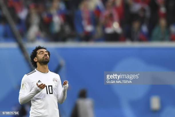 TOPSHOT Egypt's forward Mohamed Salah prays during the Russia 2018 World Cup Group A football match between Russia and Egypt at the Saint Petersburg...