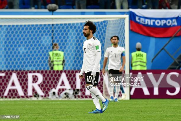 Egypt's forward Mohamed Salah reacts after Egypt's defender Ahmed Fathi own goal during the Russia 2018 World Cup Group A football match between...