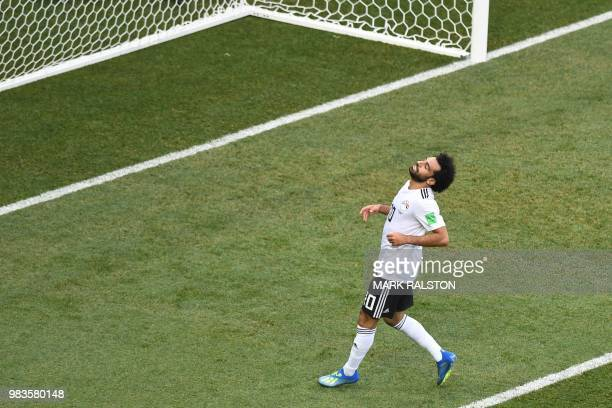 TOPSHOT Egypt's forward Mohamed Salah reacts after missing a shot during the Russia 2018 World Cup Group A football match between Saudi Arabia and...