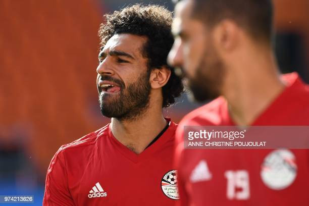 Egypt's forward Mohamed Salah reacts beside teammate Abdallah Said during a training session at Ekaterinburg Stadium in Ekaterinburg on June 14 a day...