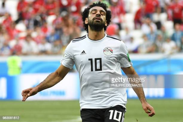 TOPSHOT Egypt's forward Mohamed Salah reacts during the Russia 2018 World Cup Group A football match between Saudi Arabia and Egypt at the Volgograd...