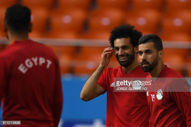 Egypt's forward Mohamed Salah smiles beside teammate Abdallah Said during a training session at Ekaterinburg Stadium in Ekaterinburg on June 14 a day...