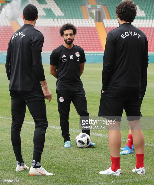 Egypt's forward Mohamed Salah speaks to Egypt's defender Ahmed Hegazi during a training session during the Russia 2018 World Cup football tournament...