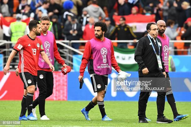Egypt's forward Mohamed Salah talks with Egypt's midfielder Abdallah Said on the pitch after the final whistle of the Russia 2018 World Cup Group A...