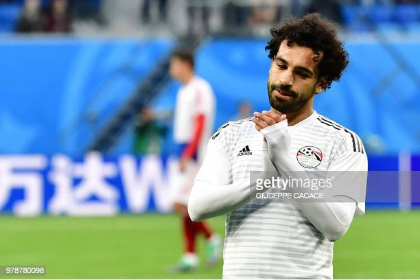TOPSHOT Egypt's forward Mohamed Salah warms up before the Russia 2018 World Cup Group A football match between Russia and Egypt at the Saint...