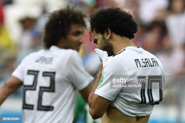 Egypt's forward Mohamed Salah wipes his face during the Russia 2018 World Cup Group A football match between Saudi Arabia and Egypt at the Volgograd...