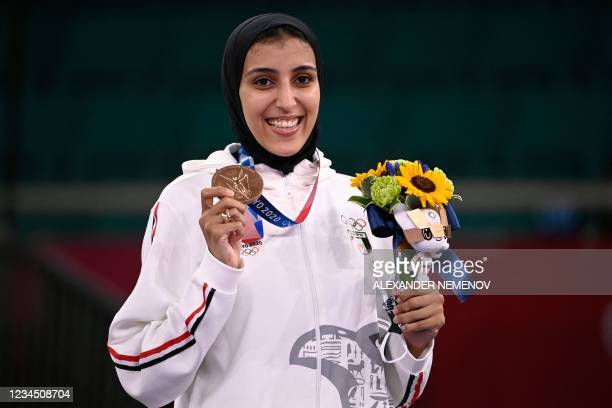 Egypt's Giana Lotfy poses with her bronze medal in the women's kumite -61kg at a ceremony in the karate competition during the Tokyo 2020 Olympic...