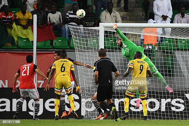 TOPSHOT Egypt's goalkeeper Ahmed ElShenawy punches the ball away from the goal during the 2017 Africa Cup of Nations group D football match between...
