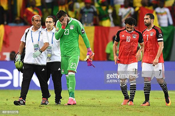 Egypt's goalkeeper Ahmed ElShenawy reacts as he walks off the pitch due to an injury during the 2017 Africa Cup of Nations group D football match...