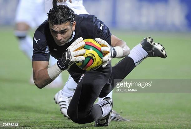 Egypt's goalkeeper Esam Kamal Tawfik El Hadary makes a save in the semifinal match Ivory Coast versus Egypt at Baba Yara Sports Stadium in Kumasi on...