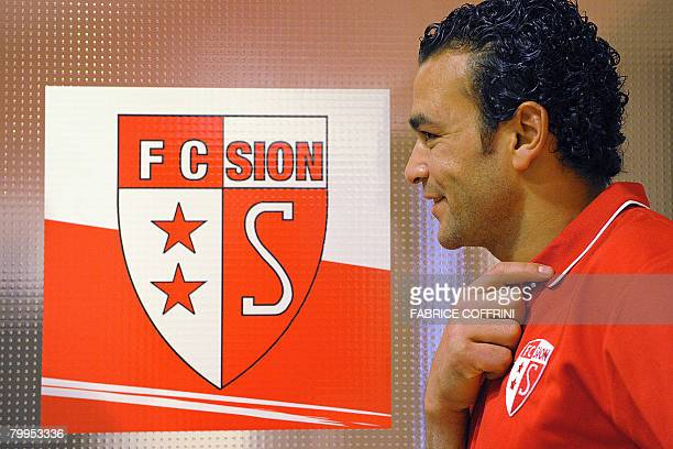 Egypt's goalkeeper Essam al-Hadary poses close to the logo of the FC Sion football club, on February 23, 2008 in Martigny. Hadary, known locally as...