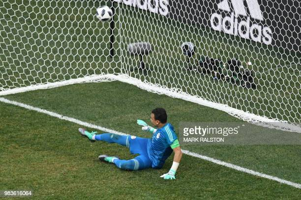 Egypt's goalkeeper Essam El Hadary concedes a penalty during the Russia 2018 World Cup Group A football match between Saudi Arabia and Egypt at the...