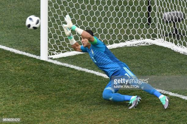 Egypt's goalkeeper Essam El Hadary dives to save a penalty during the Russia 2018 World Cup Group A football match between Saudi Arabia and Egypt at...