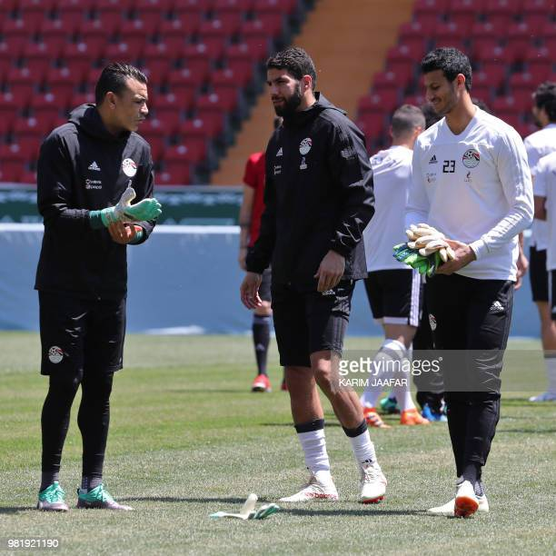 Egypt's goalkeeper Essam El Hadary Egypt's goalkeeper Sherif Ekramy and Egypt's goalkeeper Mohamed El Shenawy chat during a training session at the...