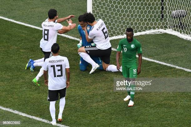 Egypt's goalkeeper Essam El Hadary is congratulated by his teammates after saving a penalty during the Russia 2018 World Cup Group A football match...