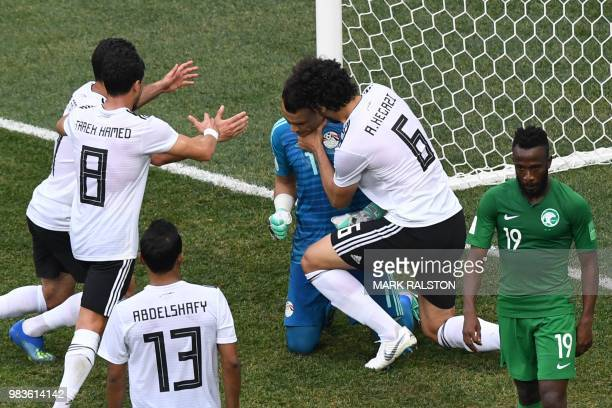 TOPSHOT Egypt's goalkeeper Essam El Hadary is congratulated by his teammates after saving a penalty during the Russia 2018 World Cup Group A football...