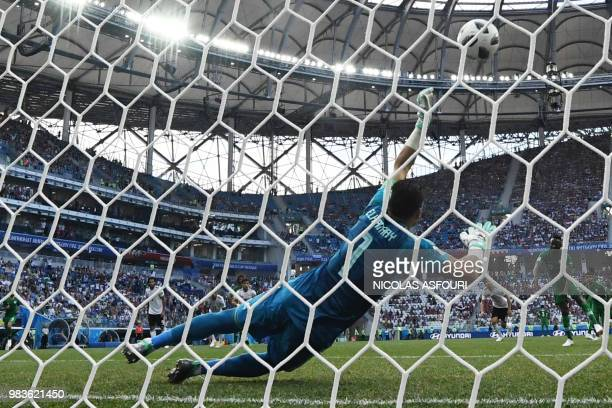 TOPSHOT Egypt's goalkeeper Essam El Hadary makes a save from the penalty spot during the Russia 2018 World Cup Group A football match between Saudi...