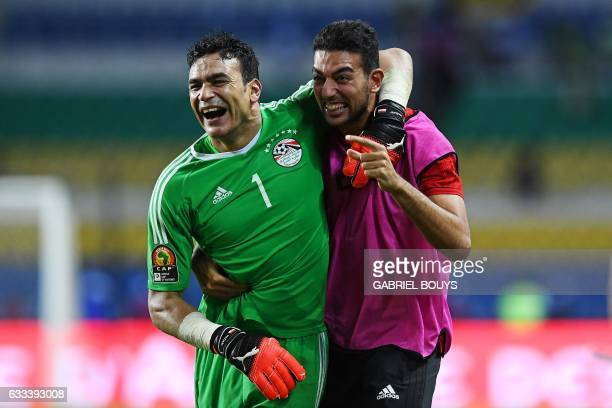 Egypt's goalkeeper Essam ElHadary celebrates with Egypt's goalkeeper Ahmed ElShenawy at the end of the penalty shootout of the 2017 Africa Cup of...