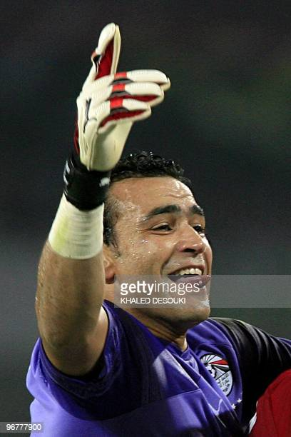 Egypt�s goalkeeper Essam ElHadary pokes his tongue as he celebrates with teammates after winning the African Cup of Nations trophy in the football...