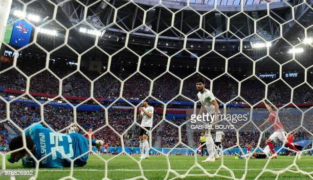 Egypt's goalkeeper Mohamed El Shenawy fails to stop the deflected shot of Russia's midfielder Aleksandr Golovin that went in off Egypt's defender...