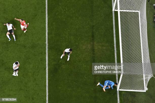 Egypt's goalkeeper Mohamed El Shenawy watches as the ball ends up in his net after a deflection by Egypt's defender Ahmed Fathi during the Russia...