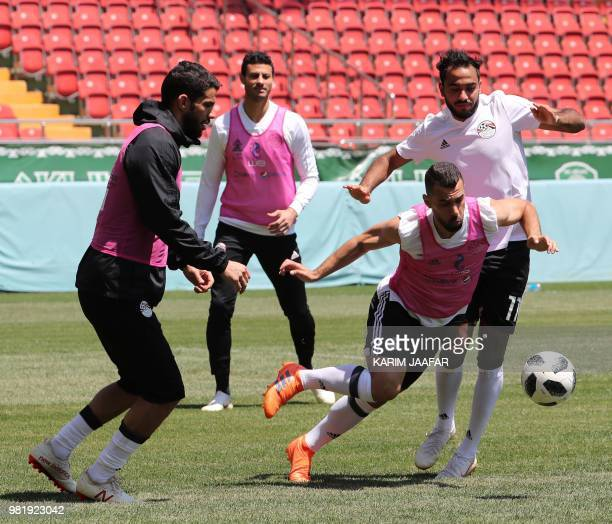 Egypt's goalkeeper Sherif Ekramy looks at teammates vying during a training session at the Akhmat Arena stadium in Grozny on June 23 2018