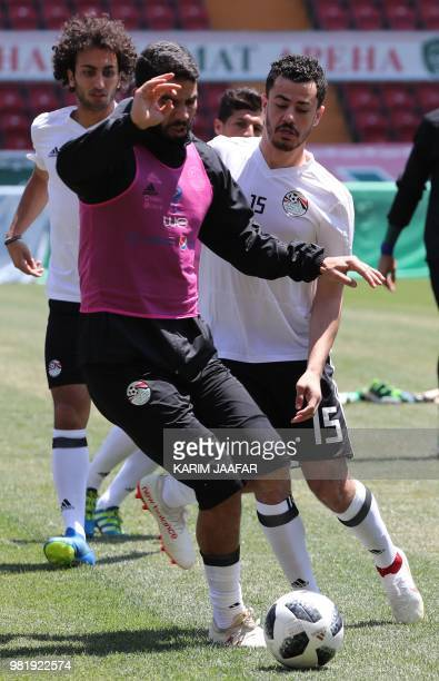 Egypt's goalkeeper Sherif Ekramy vies with Egypt's defender Mahmoud 'El Winsh' Hamdy during a training session at the Akhmat Arena stadium in Grozny...