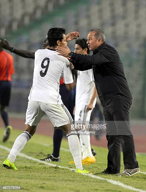 Egypt's head coach Shawki Gharib and Amr Gamal of Egypt celebrate the goal during the 2015 Africa Cup of Nations Group G qualifying football match...