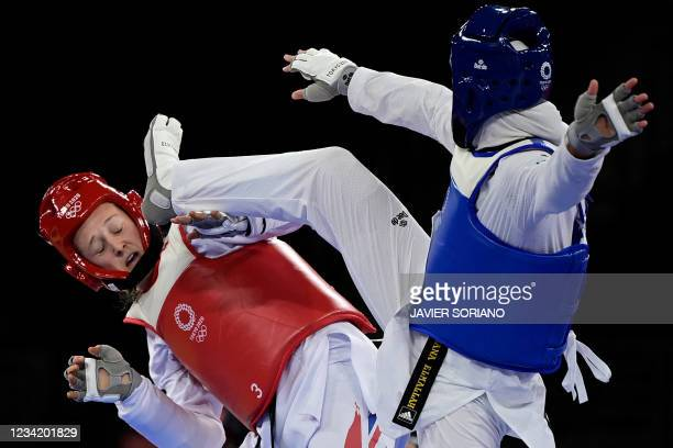 Egypt's Hedaya Wahba and Britain's Lauren Williams compete in the taekwondo women's -67kg quarter-final bout during the Tokyo 2020 Olympic Games at...