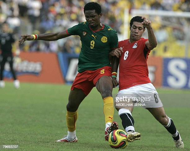 Egypts Hosny Abd Rabou Fights For The Ball With Cameroons Samuel Etoo On February