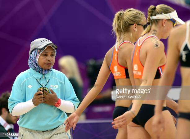 Egypt's judge Amina Abdou Elsergany waits for the players to change sides during the women' beach volleyball preliminary phase Pool E match between...