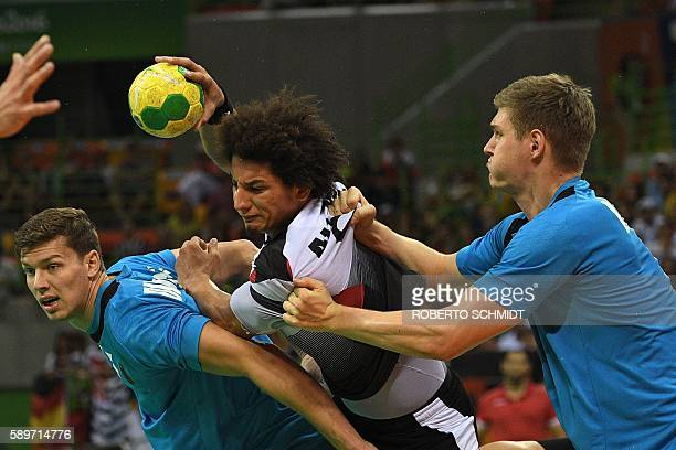 TOPSHOT Egypt's left back Ali Mohamed vies with German players during the men's preliminaries Group B handball match Germany vs Egypt for the Rio...