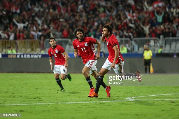 Egypts Mahmoud Hassan celebrates his goal during the Africa Cup of Nations qualifier match between Egypt and Tunis in Borg AlArab stadium in...