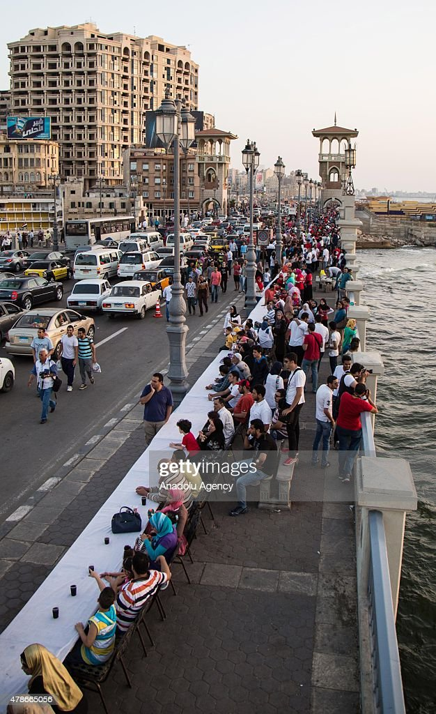 Egypts Mediterranean city of Alexandria seeks to enter the Guinness Book of World Records through preparing the longest Iftar (meal to break fasting) table extending for three kilometers along the citys coast side on June 26, 2015.