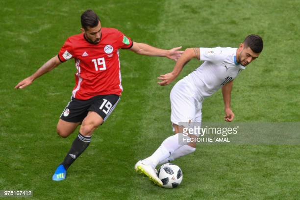 Egypt's midfielder Abdallah Said and Uruguay's midfielder Giorgian De Arrascaeta vie for the ball during the Russia 2018 World Cup Group A football...