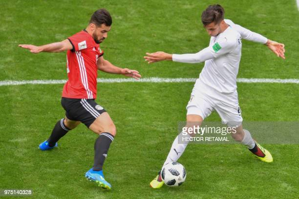 Egypt's midfielder Abdallah Said and Uruguay's midfielder Rodrigo Bentancur vie for the ball during the Russia 2018 World Cup Group A football match...