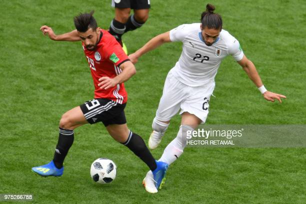 Egypt's midfielder Abdallah Said challenges Uruguay's defender Martin Caceres during the Russia 2018 World Cup Group A football match between Egypt...