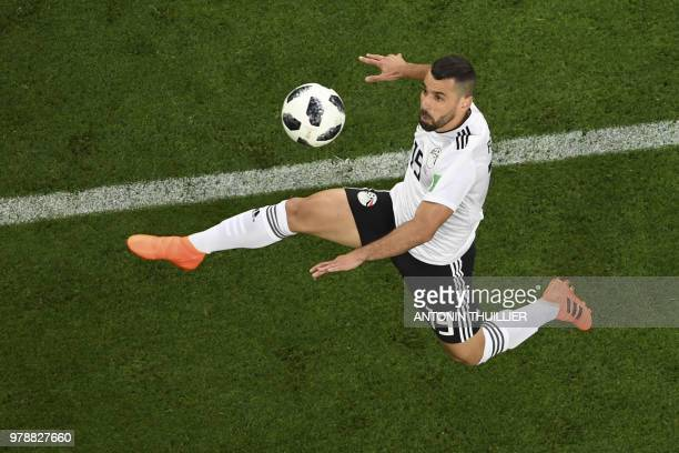 Egypt's midfielder Abdallah Said jumps to control the ball during the Russia 2018 World Cup Group A football match between Russia and Egypt at the...